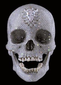 Image of Damian Hurst's scultpture 'For the Love of God' featuring an 18th century skull, non-conflict diamonds and human teeth for tanka on theme of diamonds and pearsl
