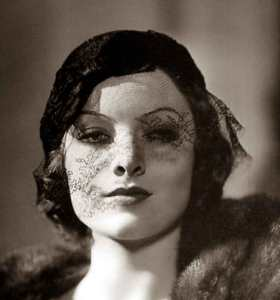 Image of Myrna Loy hat veil 1930s for haiku prompt words veiled and fray trail blazing hollywood actress