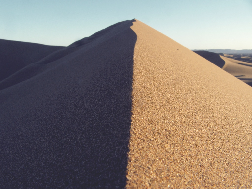 Sand dunes with shadow to illustrate 3 line tale, cretive writing story prompt