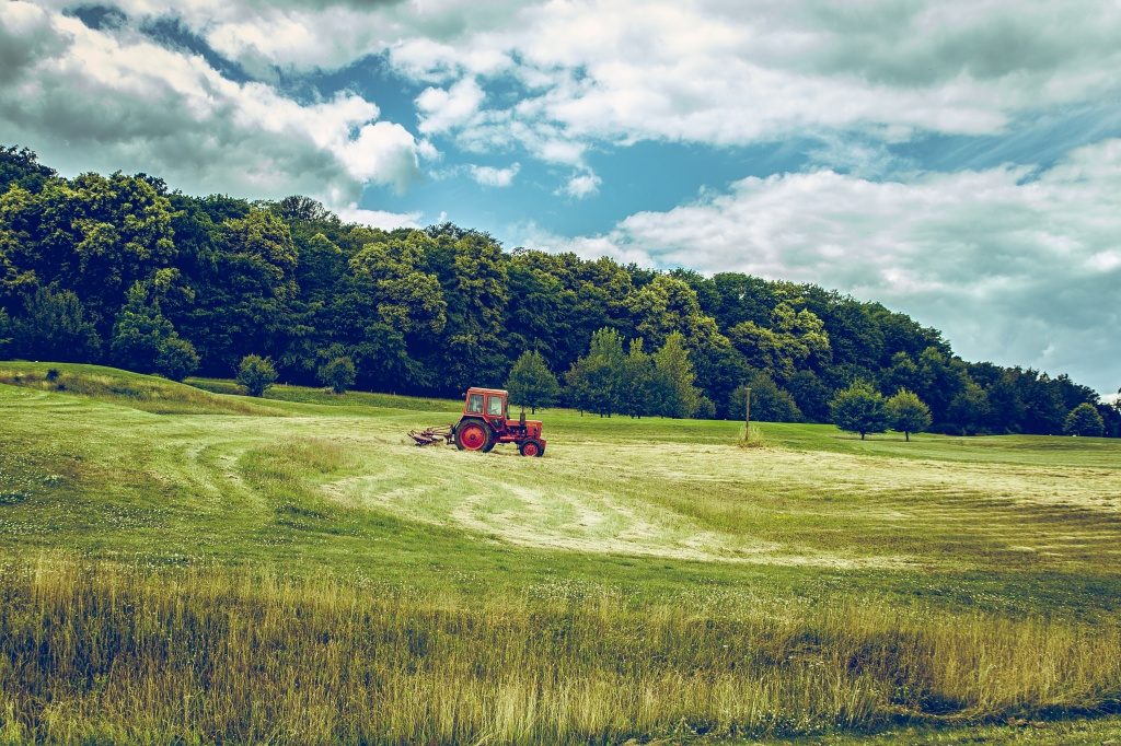 Photo of a tractor in a field used as prompt for flash fiction story