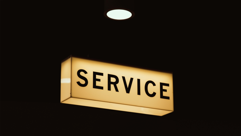 photos of an illuminated service sign used as a microfiction writing prompt.