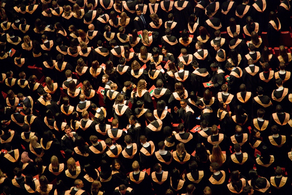 Aerial photo of a graduating class, three line tales microfiction prompt