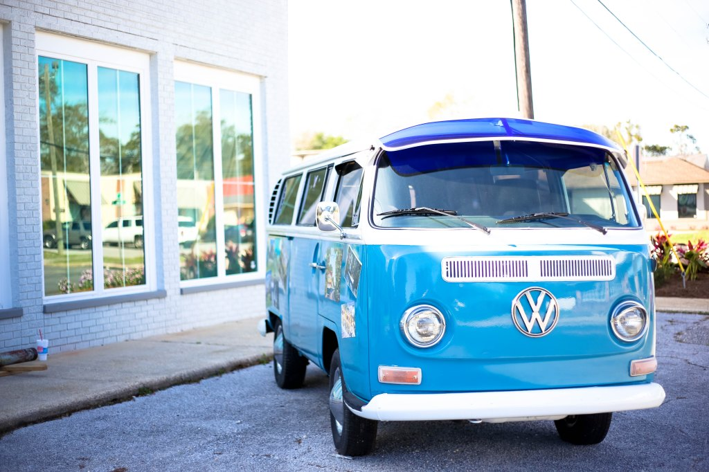 Photo of a blue volkswagon combi van used as a prompt for a microfiction story